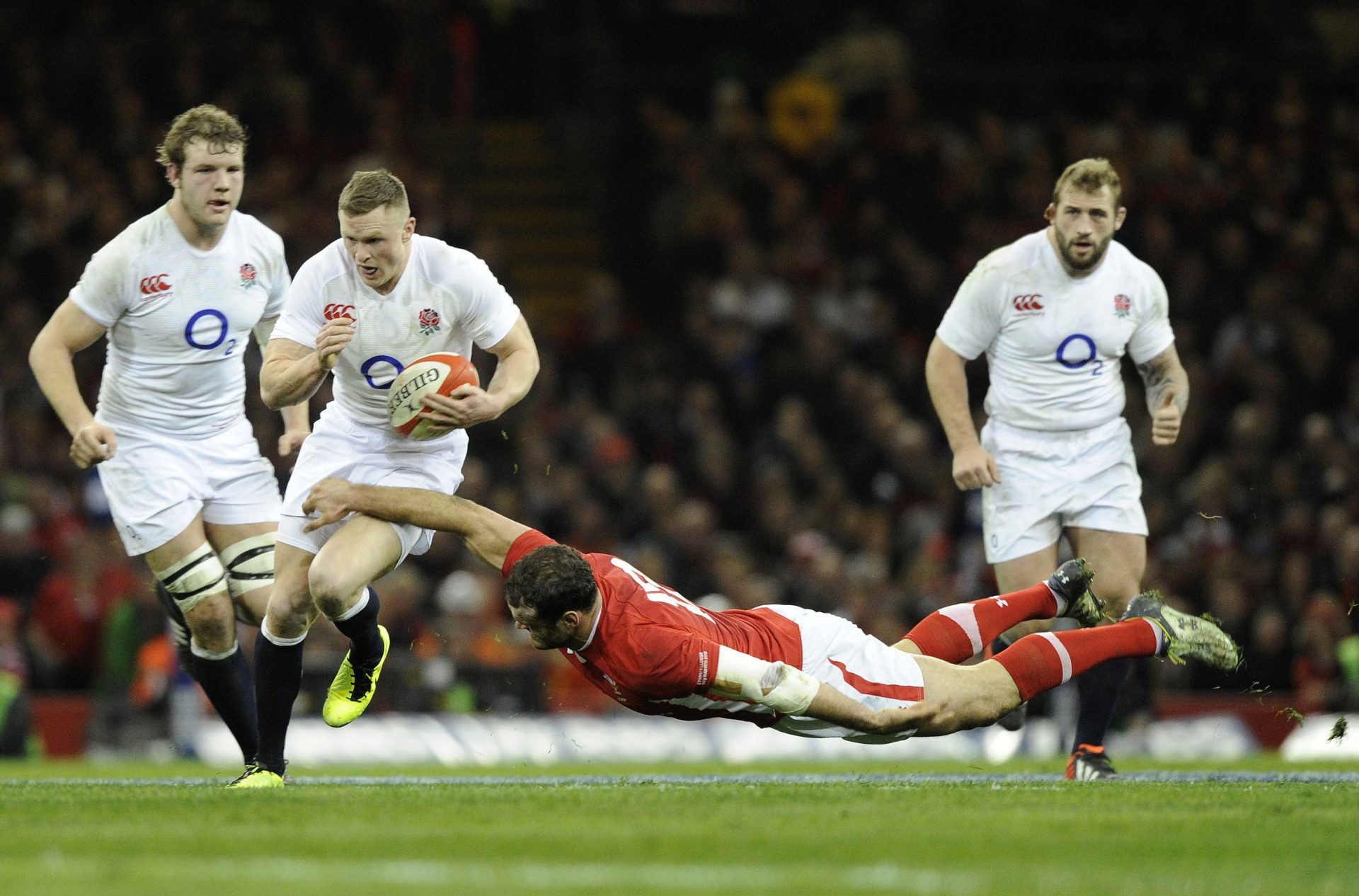 England's Ashton is tackled Wales' Roberts during their Six Nations international rugby union match at the Millennium Stadium in Cardiff